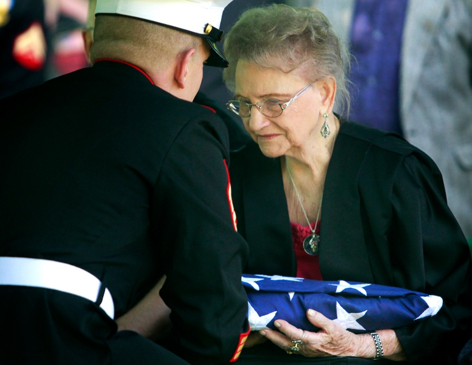 Dorothy Sobczak, Cpl. Harold W. Reed's wife at the time of his death 63 years ago, is presented with a folded American flag to honor her ex-husband's service to America at Reed's funeral service held at Ottawa Hills Memorial Park in Toledo, Ohio, on Saturday, May 24, 2014. Reed was killed during the Chosin Reservoir conflict in the Korean War and his body has been unidentified until recently. With his remains identified, Reed was finally brought back home and laid to rest with his loved ones in Toledo, 63 years after his death. (ISAAC HALE | STAFF PHOTOGRAPHER)