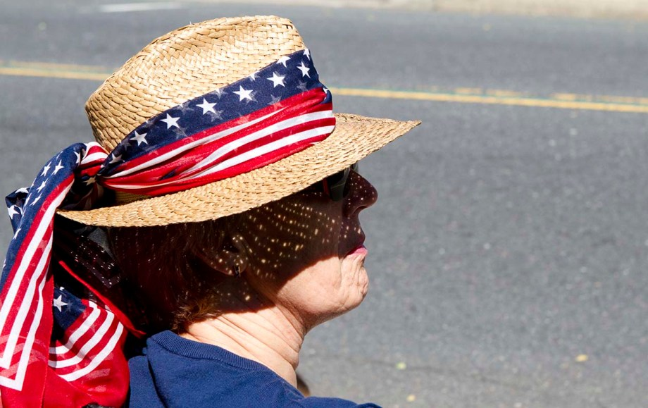 A woman waits for the Memorial Day Parade to start in Freehold, New Jersey on Monday morning. (ARIELLE BERGER | PHOTO EDITOR)