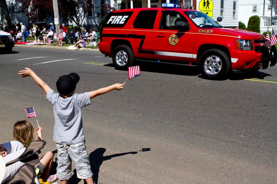 A young boy in the crowd cheers for the fire department during the Freehold, New Jersey Memorial Day Parade. (ARIELLE BERGER | PHOTO EDITOR)