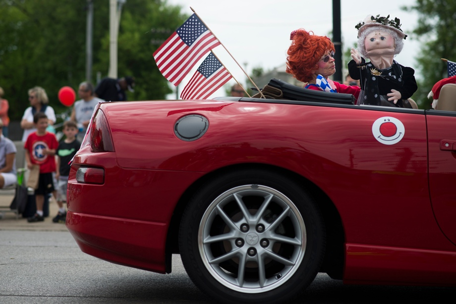 A puppet of the Queen of England waves at parade goers from a car sponsored by The Clowns of Waukesha during the Elm Grove Memorial Day Parade on Monday, May 26, 2014 in Elm Grove, Wis.  The Clowns of Waukesha is a non-profit organization that participates in the parade each year. (KATIE KLANN | PHOTO EDITOR)