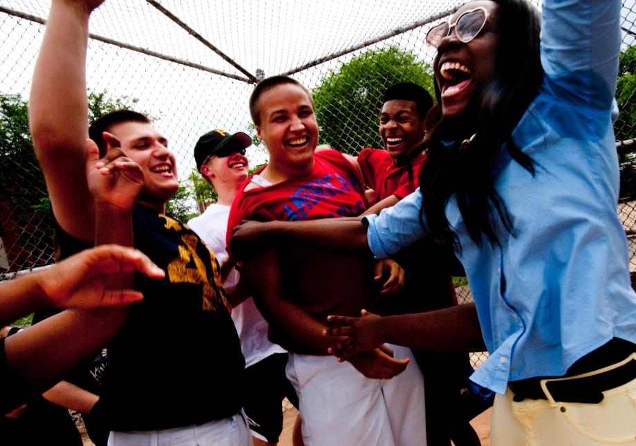 Juniors of the Pittsburgh Creative and Performing Arts School Instrumental Department celebrate after junior Marcus Kernan hit a home run during their annual softball tournament in West Park on the North Side on Monday, June 2, 2014. (EMILY HARGER | PHOTO EDITOR)