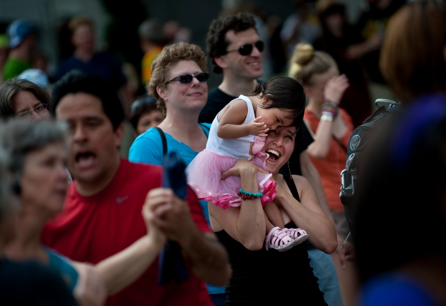 Becky Yhap and her daughter, Angela Yhap, dance during the performance of Machete Kisumontao, a seven-piece Puerto Rican music band, on the Stanwix Stage at the Three Rivers Arts Festival on Sunday, June 8, 2014. (EMILY HARGER | PHOTO EDITOR)