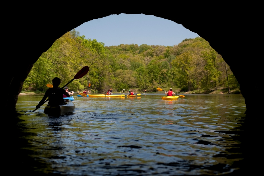 Kayakers paddle through the tunnel at North Park Lake on Saturday, May 24, 2014. Kayak Pittsburgh, located along North Park Lake, opened for the season on May 24, 2014 for Memorial Day weekend. (EMILY HARGER | PHOTO EDITOR)