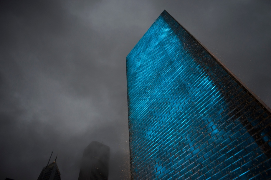 Crown Fountain in Millennium Park lights up the sky after a storm in Chicago, Ill. on Saturday, June 21, 2014.