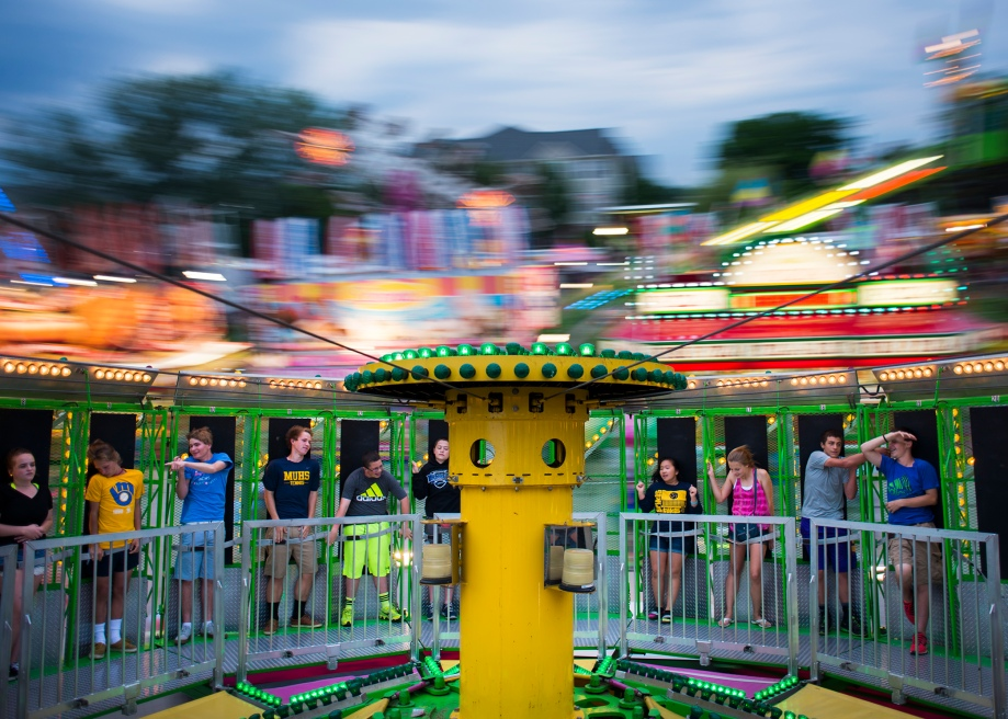 "Fair goers attempt to fight the force of gravity by sticking out their arms on the ride ""Zero Gravity"" on Saturday, June 7, 2014 at the St. John Vianney Festival in Brookfield, Wis."